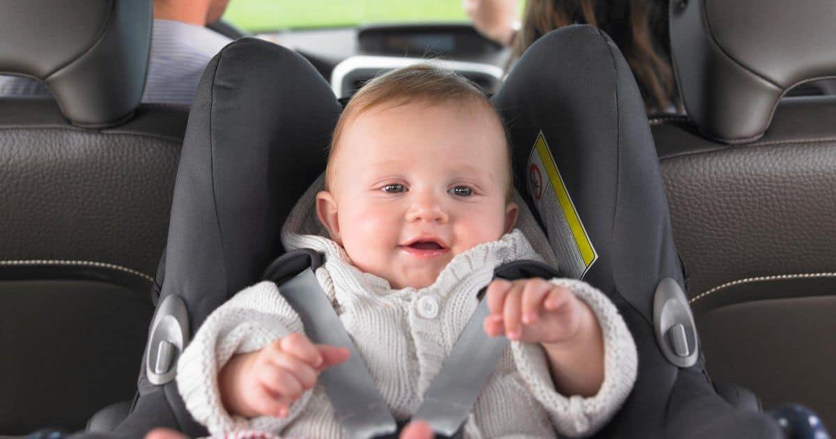 Smiling baby in car seat